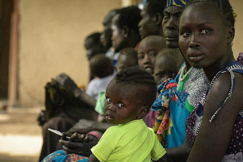 Patients wait for treatment at the Udier primary health and care center supported by the International Committee of the Red Cross (ICRC) in Udier, in the Upper Nile region, of South Sudan (AFP Photo/SIMON MAINA)