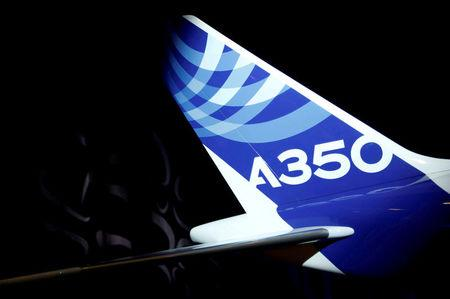 FILE PHOTO: The logo of an Airbus A350-1000 is pictured on a scale model during its maiden flight event in Colomiers near Toulouse, Southwestern France, November 24, 2016.  REUTERS/Regis Duvignau/File Photo