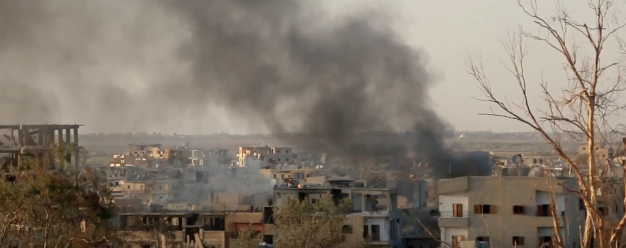 """<p>Large-scale destruction was reported in Raqqa city could be seen in a video shared by a Kurdish outlet on October 13. It was published as last minute negotiations for evacuating Islamic State fighters continued.</p><p>Kurdish troops, with support from international coalition airstrikes, after weeks of advances inside Raqqa, told <a href=""""https://uk.reuters.com/article/uk-mideast-crisis-syria-raqqa/islamic-state-faces-imminent-raqqa-defeat-syrian-ypg-says-idUKKBN1CJ04S"""" target=""""_blank"""">Reuters</a> that they expected to fully capture the city on October 14.</p><p>The UK based Syrian Observatory for Human Rights on October 13 <a href=""""http://www.syriahr.com/en/?p=76204"""" target=""""_blank"""">reported</a> that a deal had been struck between local officials, the coalition and IS fighters to allow buses to take fighters and their families out of the city. Credit: <span class=""""caps"""">YPJ</span> via Storyful</p>"""