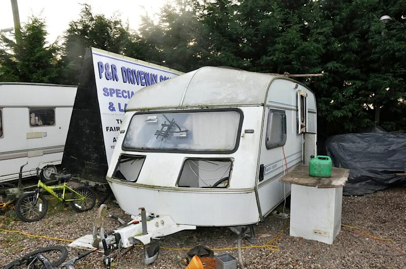 A dilapidated caravan at the Rooney family's site (Picture: SWNS)