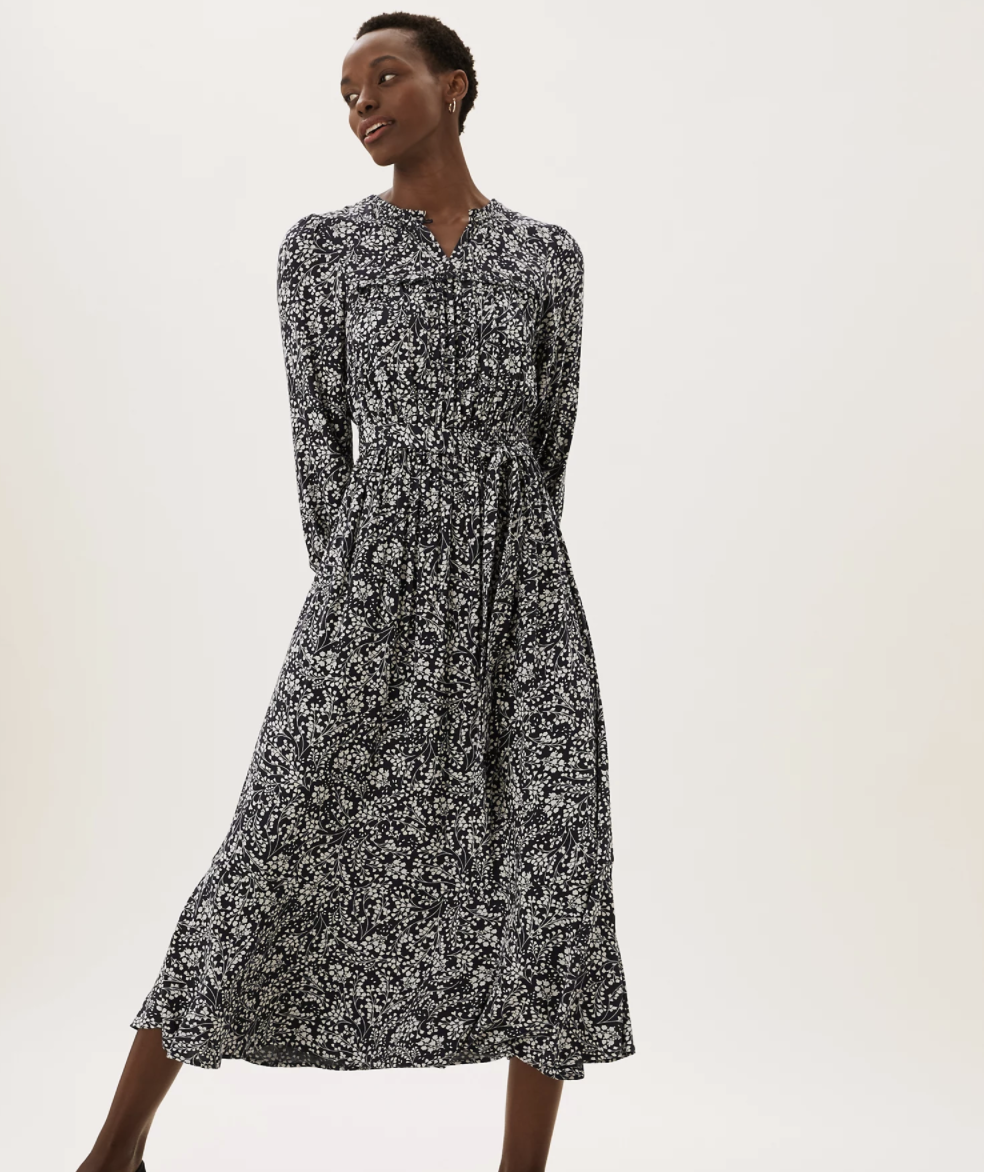 The floral dress can be worn by itself or layered with knitwear. (Marks & Spencer)