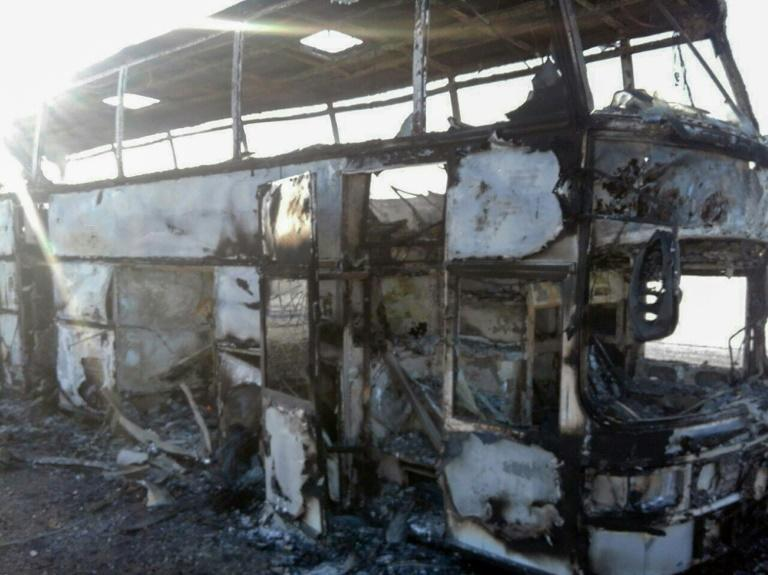 The fire spread very quickly, gutting the bus and killing 52 of the 57 people on board, Kazakh officials said