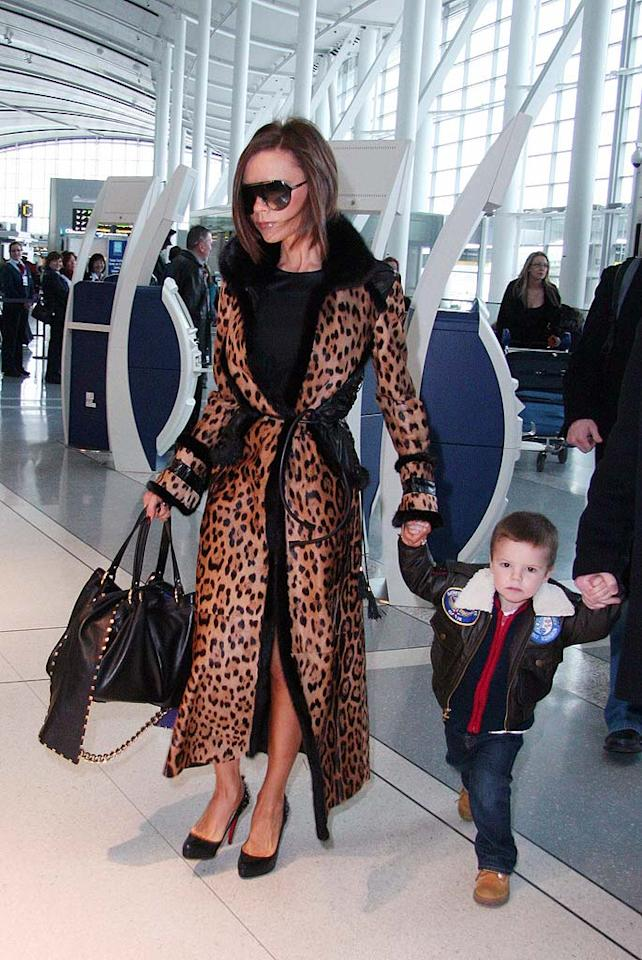 """The Spice Girls arrive at the Toronto Airport in individual SUVs. Little Cruz Beckham has already mastered his mum's trademark pout. O'Neill/White/<a href=""""http://www.infdaily.com"""" target=""""new"""">INFDaily.com</a> - February 5, 2008"""