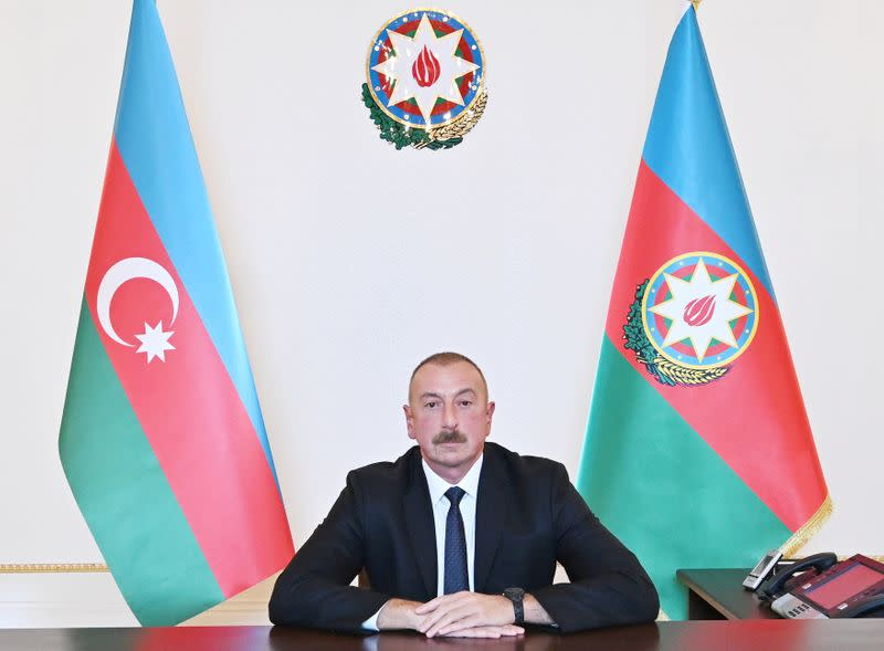 Azerbaijan's President Ilham Aliyev holds during an address to the nation in Baku