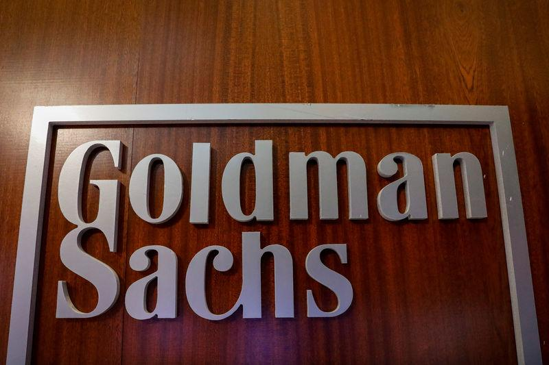 The Goldman Sachs company logo is seen in the company's space on the floor of the NYSE in New York