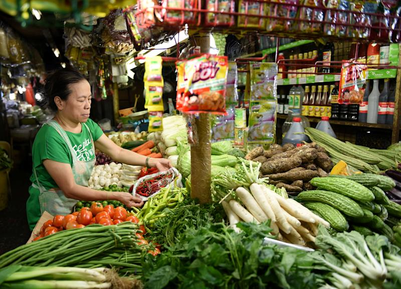 File Photo: A woman arranges vegetable in a market stall in Edsa Kamias in Quezon City, Philippines. REUTERS/Dondi Tawatao