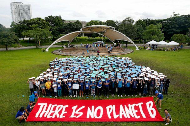 PHOTO: Environmental activists, mostly students, display their message in front of 'a human globe' formation to coincide with the global protests on climate change Sept. 20, 2019, at the University of Philippines campus in Quezon city northeast of Manila. (Bullit Marquez/AP)