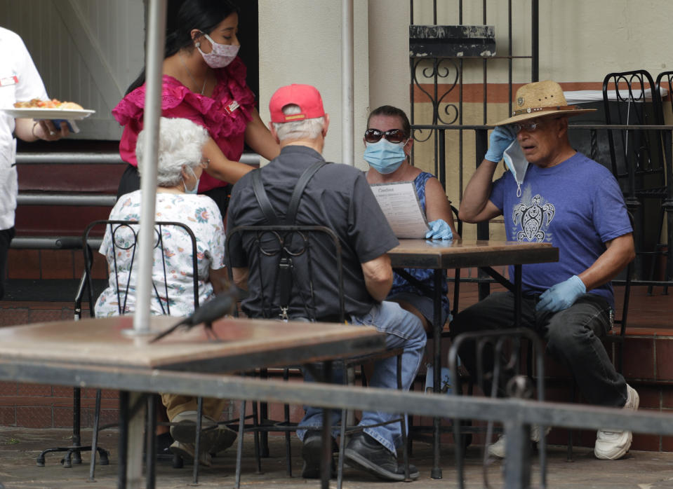 Diners at a restaurant that has reopened in San Antonio, Monday, June 15, in San Antonio. Source: AAP