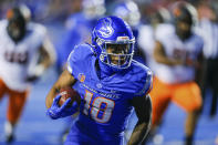 Boise State wide receiver Billy Bowens (18) turns upfield with the ball after a reception against Oklahoma State during the first half of an NCAA college football game Saturday, Sept. 18, 2021, in Boise, Idaho. (AP Photo/Steve Conner)