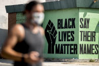 FILE - In this July 13, 2020, file photo, a black lives matter mural is visible in the Shaw neighborhood in Washington. The Black Lives Matter Global Network Foundation, which grew out of the creation of the Black Lives Matter movement, is formally expanding a $3 million financial relief fund that it quietly launched in February 2021, to help people struggling to make ends meet during the ongoing coronavirus pandemic. (AP Photo/Andrew Harnik, File)