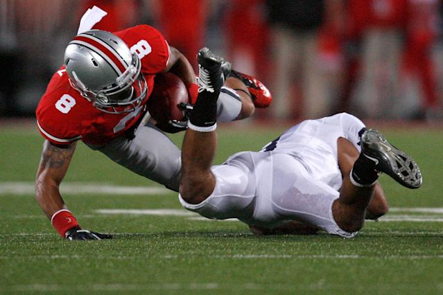 COLUMBUS, OH - NOVEMBER 19: DeVier Posey #8 of the Ohio State Buckeyes is tackled by D'Anton Lynn #8 of the Penn State Nittany Lions during the fourth quarter on November 19, 2011 at Ohio Stadium in Columbus, Ohio. Penn State defeated Ohio State 20-14. (Photo by Kirk Irwin/Getty Images)