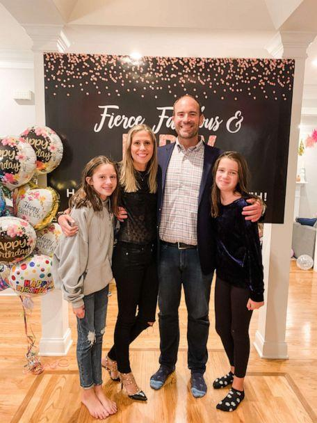 Corey Ryan and Elizabeth Long pose for a photo with Long's two daughters.  (Elizabeth Long)