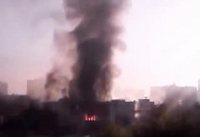 In this image taken from video obtained from the Syria 2011 Archives, which has been authenticated based on its contents and other AP reporting, black smoke rises from Syria's army command headquarters in Damascus, Syria, on Wednesday, Sept. 26, 2012.  Twin blasts targeting Syria's army command headquarters rocked the capital on Wednesday, setting off hours of sporadic gunbattles and a raging fire inside the heavily guarded compound, state-run media and witnesses said. (AP Photo/Syria 2011 Archives via AP video)