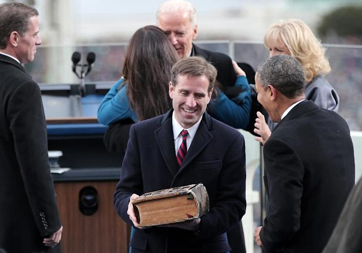 Beau Biden and US President Barack Obama chat after Beau Biden's father, US Vice President Joe Biden, was sworn in during the inauguration on the West Front of the US Capitol January 21, 2013 in Washington, DC (AFP Photo/Win McNamee)
