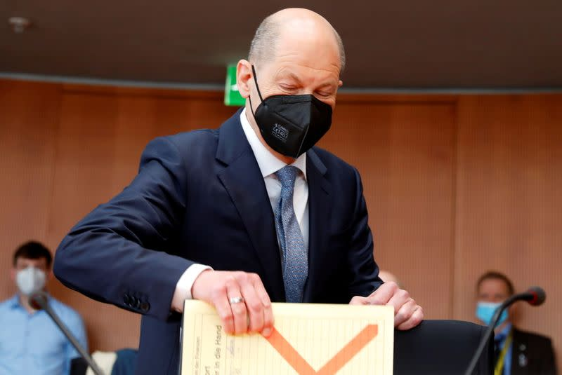 FILE PHOTO: German Finance Minister Scholz testifies before a parliament committee, in Berlin