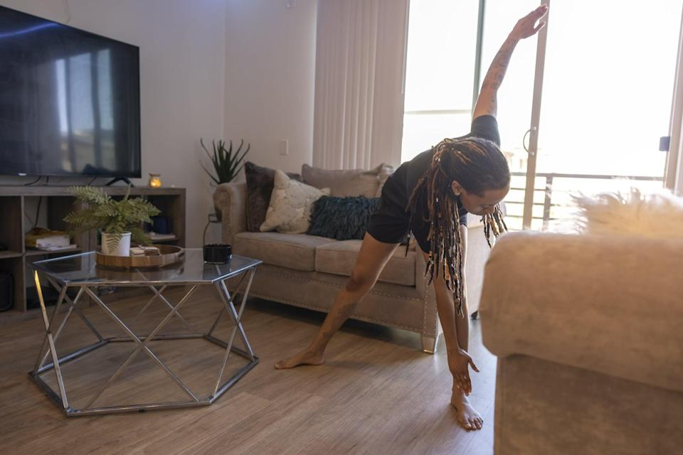 """<p>""""Exercise is one of the most efficient ways that our body biologically <a href=""""https://www.popsugar.com/fitness/best-type-exercise-to-relieve-stress-47339929"""" class=""""link rapid-noclick-resp"""" rel=""""nofollow noopener"""" target=""""_blank"""" data-ylk=""""slk:processes stress out of it"""">processes stress out of it</a>,"""" Dr. Wang explained. Something Moffa always says is """"emotion is better in motion,"""" which applies to anxiety and grief because, she noted, they get """"stuck"""" in your body and cause tightness in your chest, shortness of breath, and other physical symptoms. Pick your movement of choice - she suggested even just dancing out your emotions to music. Try yoga or head out<a href=""""https://www.popsugar.com/fitness/Outdoor-Interval-Running-Workout-46197010"""" class=""""link rapid-noclick-resp"""" rel=""""nofollow noopener"""" target=""""_blank"""" data-ylk=""""slk:for a run""""> for a run</a> (Dr. Wang's go-to) to let what you're feeling move through you.</p>"""