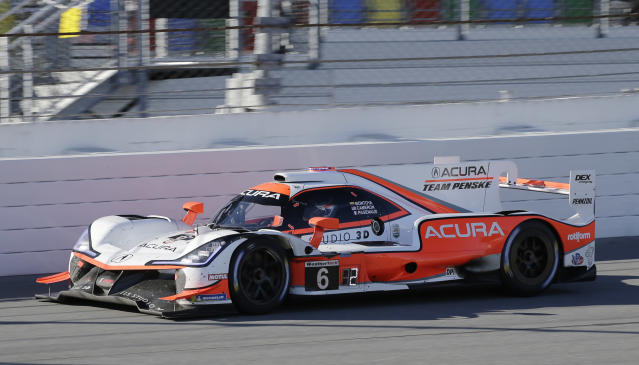 Acura Team Penske (6) drives on-track during the Rolex 24-hour auto race at Daytona International Speedway, Saturday, Jan. 25, 2020, in Daytona Beach, Fla. (AP Photo/Terry Renna)