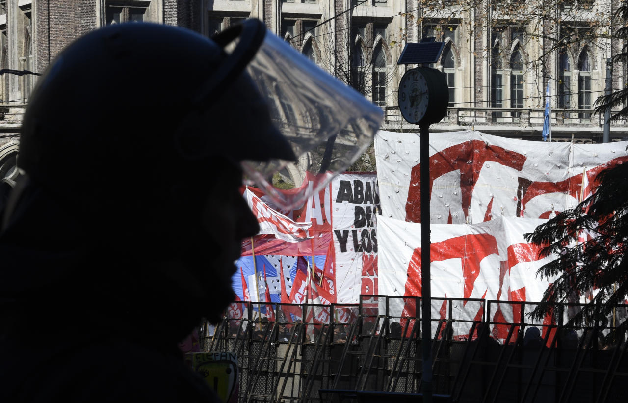 A policeman stands guard during demonstrators protesting against the International Monetary Fund near the G20 Finance Minister and Central Bank Governors meeting in Buenos Aires, Argentina, Saturday, July 21, 2018. (AP Photo/Gustavo Garello)