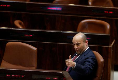 Israeli Education Minister Naftali Bennett gestures during a vote on a bill at the Knesset, the Israeli parliament, in Jerusalem February 6, 2017. REUTERS/Ammar Awad