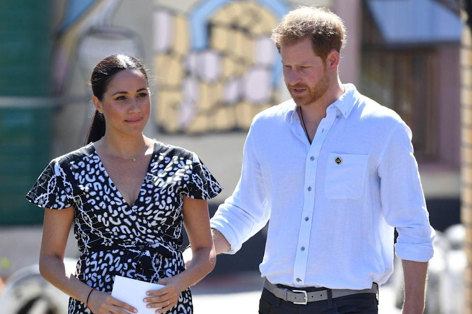<p>Harry and Meghan</p> (PA)