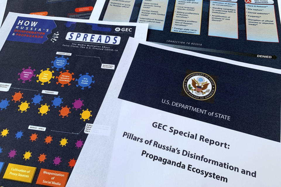 Pages from the U.S. State Department's Global Engagement Center report released on Aug. 5, 2020, are seen in this photo. The State Department says Russia is using a well-developed online operation that includes a loose collection of proxy websites to stir up confusion around the coronavirus by amplifying conspiracy theories and misinformation. The department detailed a Russian-backed misinformation cycle that spreads false information online through state officials and state-funded media reports, by infiltrating U.S. social media conversation, and leveraging a deceptive internet framework of websites. (AP Photo/Jon Elswick)