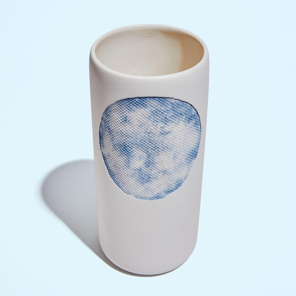 """<p>""""To make these vases, the artisans at Atelier Murmur use pieces of thin silk cloth dipped in indigo dye and press them onto the ceramic before it goes into the kiln. The fabric burns off at high temps, but leaves behind its delicate color and texture. The vase is perfect for small flowers, and white so it goes with everything.""""</p> <p><em>Buy it:</em> <a href=""""https://www.sage-collective.com/all-collections/a-circle-indigo-vase"""" rel=""""nofollow noopener"""" target=""""_blank"""" data-ylk=""""slk:A-Circle Indigo Vase, $90"""" class=""""link rapid-noclick-resp""""><em>A-Circle Indigo Vase, $90</em></a></p>"""