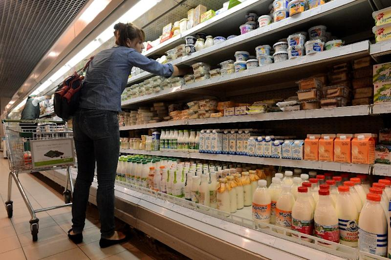 A woman looking at dairy products in a supermarket in central Moscow on August 5, 2013