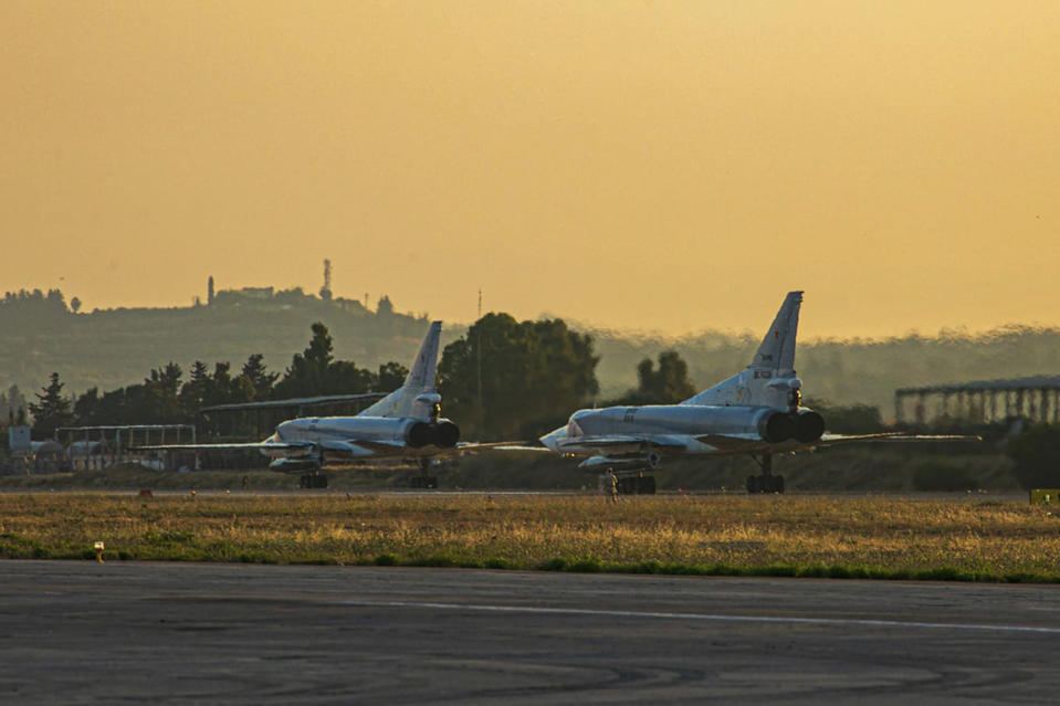 In this photo released by Russian Defense Ministry Press Service on Friday, June 25, 2021, a pair of the Russian air force's Tu-22M3 bombers taxi at the Hemeimeem air base in Syria. The Russian military on Friday launched sweeping maneuvers in the Mediterranean Sea featuring warplanes capable of carrying hypersonic missiles, a show of force amid a surge in tensions following an incident with a British destroyer in the Black Sea. (Russian Defense Ministry Press Service via AP)