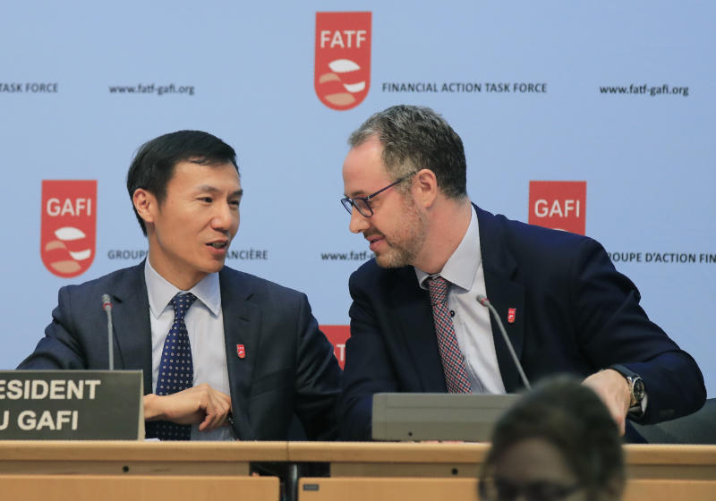 Financial Action Task Force (FATF) President Xiangmin Liu, left, and Executive Secretary of the FATF David Lewis talk to each other after a media conference at the OECD headquarters in Paris, Friday, Oct. 18, 2019. FATF a international monitoring agency has given Pakistan four months to prove it is fighting terrorism financing and money laundering or it could be put on a damaging global blacklist. (AP Photo/Michel Euler)