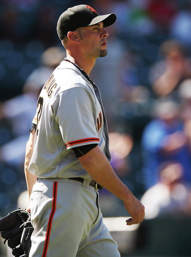 San Francisco Giants starting pitcher Ryan Vogelsong waits after giving up three-run home run to Colorado Rockies' Nolan Arenado in the fifth inning of the Rockies' 9-2 victory in a baseball game in Denver on Wednesday, Sept. 3, 2014. (AP Photo/David Zalubowski)