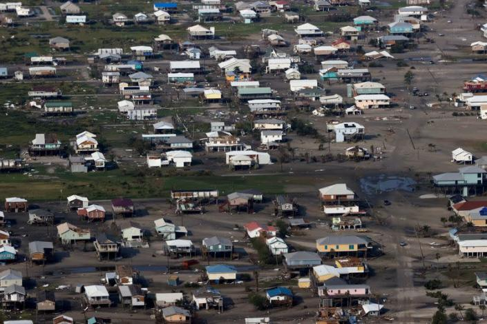 FILE PHOTO: A view shows debris and buildings damaged from Hurricane Ida during U.S. President Joe Biden's aerial tour of communities in Laffite, Grand Isle, Port Fourchon