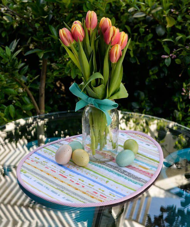 """<p>If you save your selvages from sewing projects, you can make an adorable table topper out of it. After you finish sewing them together, cut out an egg shape and line with a binding. </p><p><em><a href=""""https://heyletsmakestuff.com/quilted-easter-table-topper/"""" rel=""""nofollow noopener"""" target=""""_blank"""" data-ylk=""""slk:Get the tutorial at Hey, Let's Make Stuff »"""" class=""""link rapid-noclick-resp"""">Get the tutorial at Hey, Let's Make Stuff »</a></em></p>"""