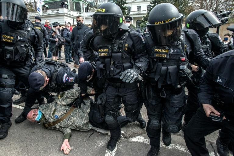 Police detain a pro-Russia demonstrator amid a protest outside the Russian Embassy in Prague