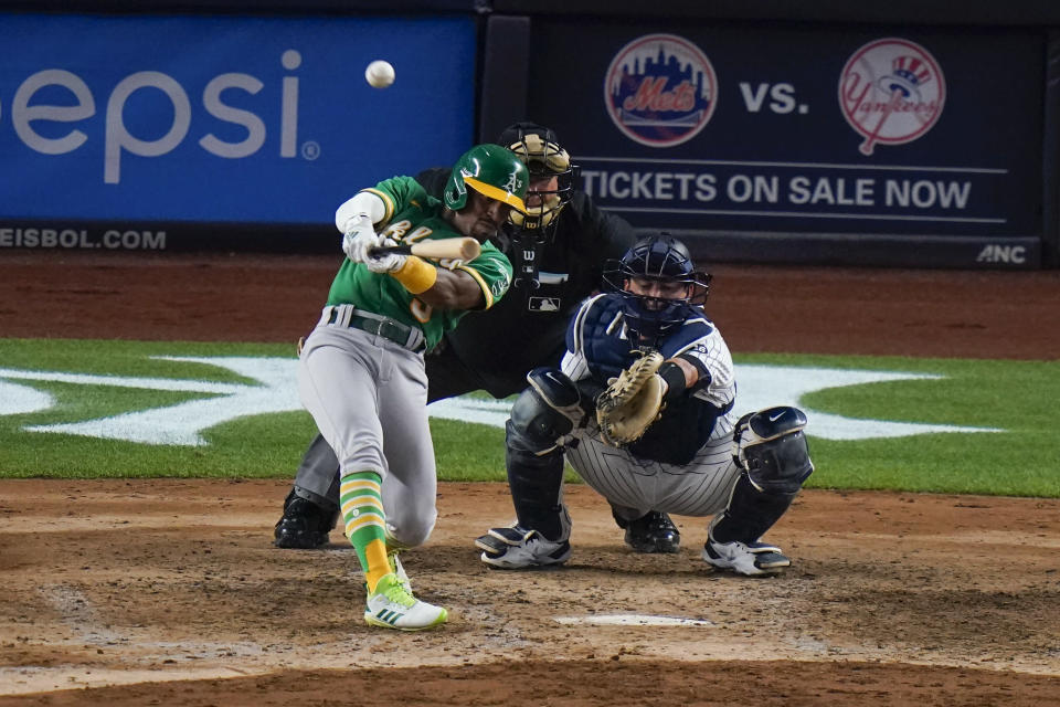 Oakland Athletics' Tony Kemp hits a three-run home run during the sixth inning of the team's baseball game against the New York Yankees Friday, June 18, 2021, in New York. (AP Photo/Frank Franklin II)