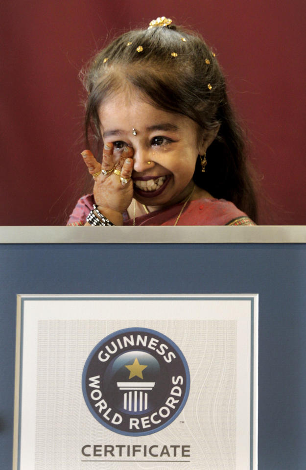 Jyoti Amge wipes her tears after getting the title of the shortest Woman of the world, in Nagpur, India, Friday, Dec. 16, 2011. Amge was declared the shortest woman in the world measuring 62.8 centimeters (24.7 inches) by the Guinness World Records. (AP Photo/Manish Swarup)