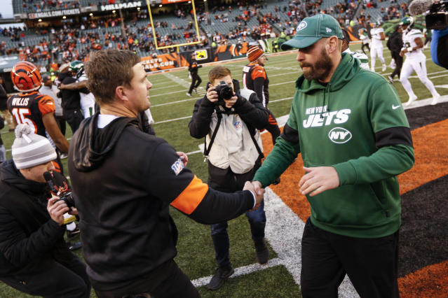 Cincinnati Bengals head coach Zac Taylor, left, and New York Jets head coach Adam Gase, right, meet on the field after an NFL football game, Sunday, Dec. 1, 2019, in Cincinnati. (AP Photo/Frank Victores)