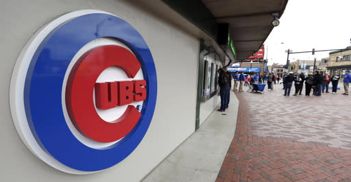 FILE - This April 15, 2013, file photo shows the Chicago Cubs logo on the exterior of Wrigley Field, in Chicago. The Chicago Cubs and Sinclair Broadcast Group are launching a regional sports network in 2020 that will be the teams exclusive TV home. The Cubs said Wednesday, Feb. 13, 2019, the Marquee Sports Network will carry live game broadcasts and pregame and postgame coverage. (AP Photo/M. Spencer Green, File)