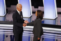 FILE - In this July 31, 2019, file photo, fFormer Vice President Joe Biden shakes hands with Sen. Kamala Harris, D-Calif., before the second of two Democratic presidential primary debates at the Fox Theatre in Detroit. Democratic presidential candidate former Vice President Joe Biden has chosen Harris as his running mate. (AP Photo/Paul Sancya, File)