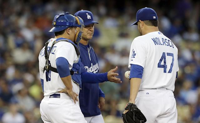Los Angeles Dodgers manager Don Mattingly takes the ball from starting pitcher Ricky Nolasco as catcher Tim Federowicz watches in the second inning of a baseball game against the San Francisco Giants in Los Angeles on Saturday, Sept. 14, 2013. (AP Photo/Reed Saxon)