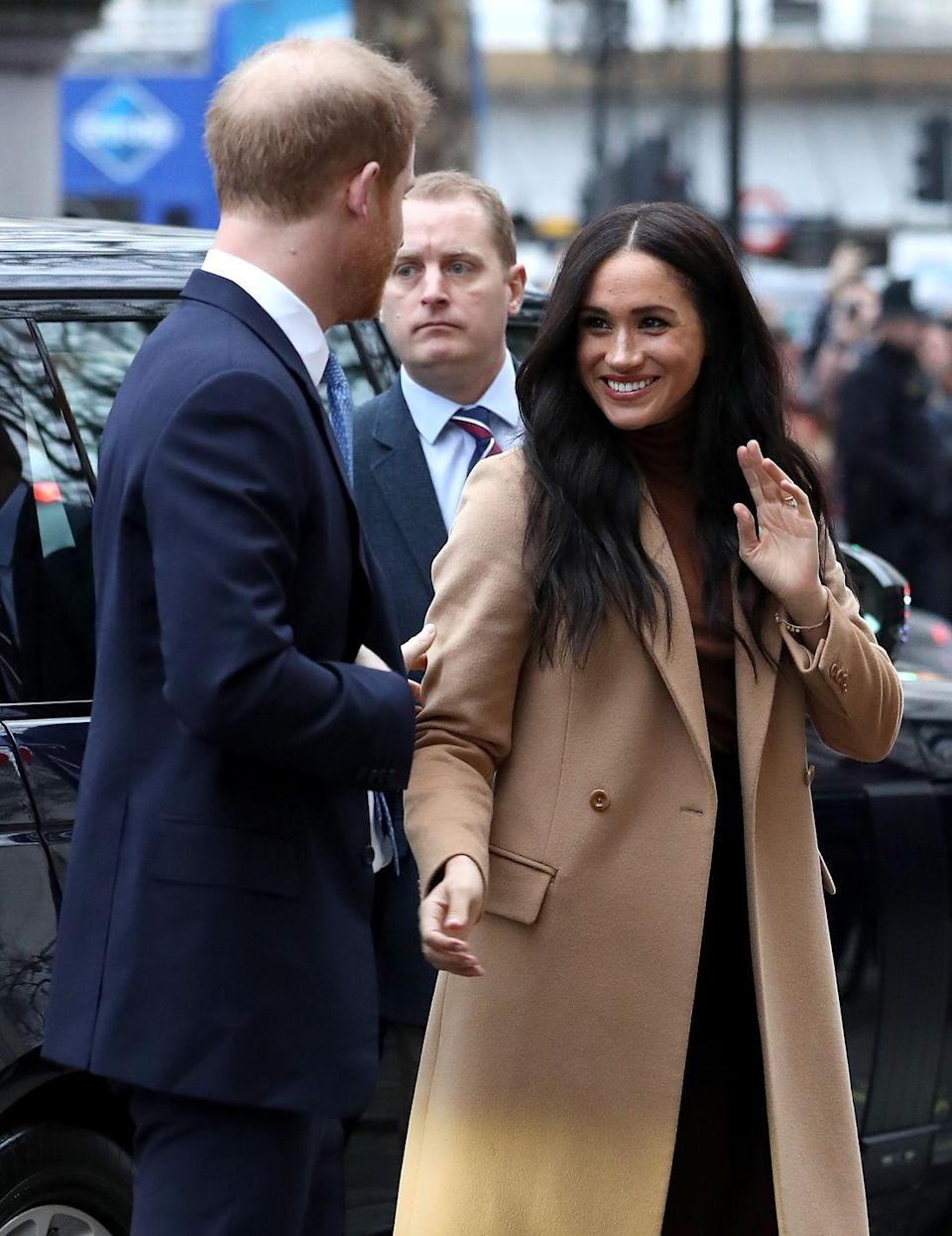 <p>Meghan was spotted wearing this camel coat alongside her boo (also known as the Duke of Sussex) while arriving at Canada House in London. Also, those waves! Please give us your secret, Megs. </p>