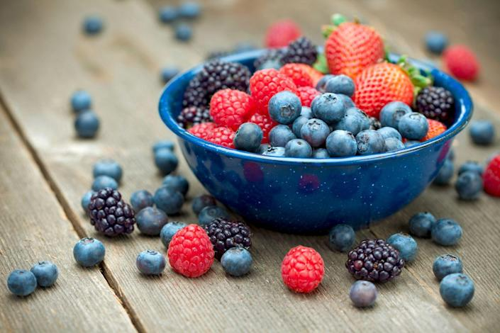 """<p>""""Berries like blueberries, <a href=""""https://www.prevention.com/food-nutrition/healthy-eating/a26537540/health-benefits-of-strawberries/"""" rel=""""nofollow noopener"""" target=""""_blank"""" data-ylk=""""slk:strawberries"""" class=""""link rapid-noclick-resp"""">strawberries</a>, and raspberries are packed with fiber which helps to slow the digestive process,"""" says Williams. """"The result is that you feel fuller longer, and your blood sugar is kept in check, which can be key for keeping tabs on appetite and cravings. All berries are also packed with antioxidants and phytochemicals that reduce the risk of inflammation leading to obesity and metabolic syndrome.""""</p>"""