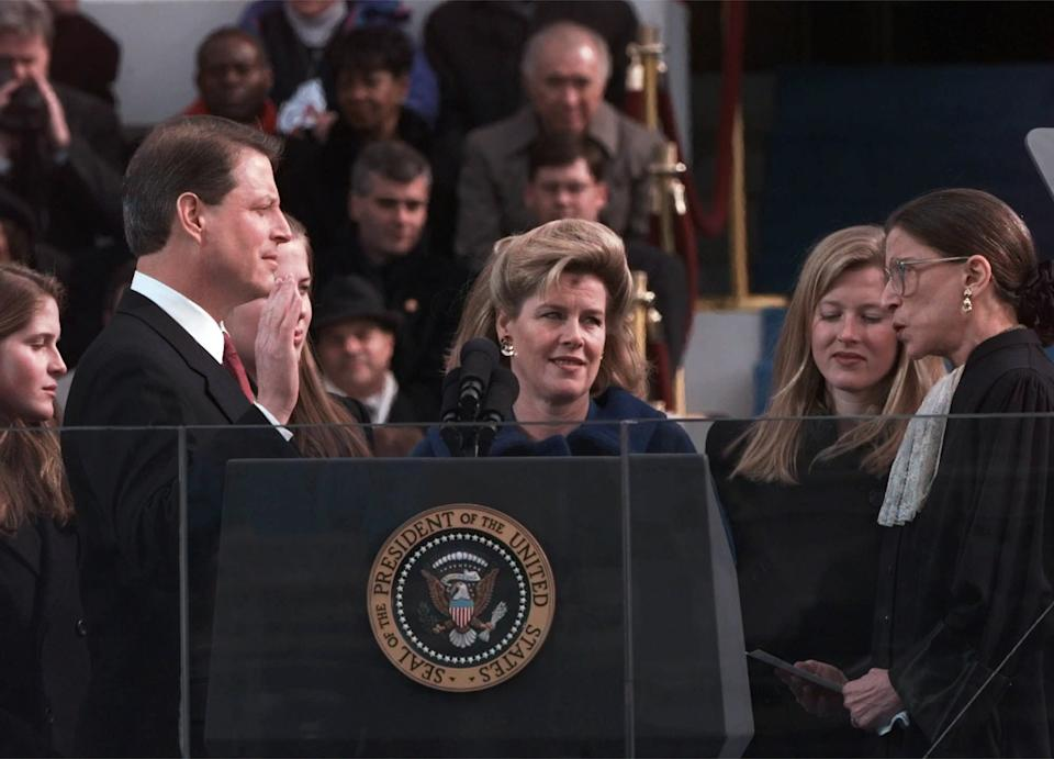 Vice President Al Gore, with his wife, Tipper Gore, is sworn in by Associate Justice Ruth Bader Ginsburg. (Photo: Ron Edmonds/AP)