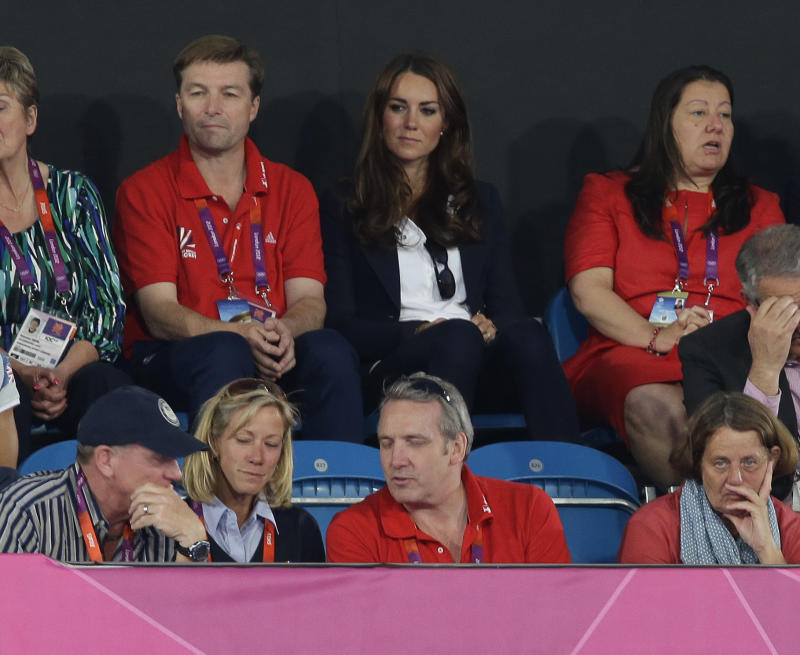 Kate Middleton, the Duchess of Cambridge, center second row, watches a women's hockey semifinal match between Argentina and Britain at the 2012 Summer Olympics, Wednesday, Aug. 8, 2012, in London.  (AP Photo/Bullit Marquez)