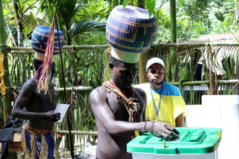 Young Upe men cast their votes in the Bougainville Referendum at the men's only polling station in Teau Bougainville, Papua New Guinea on November 8, 2019 (AFP Photo/Jeremy MILLER)