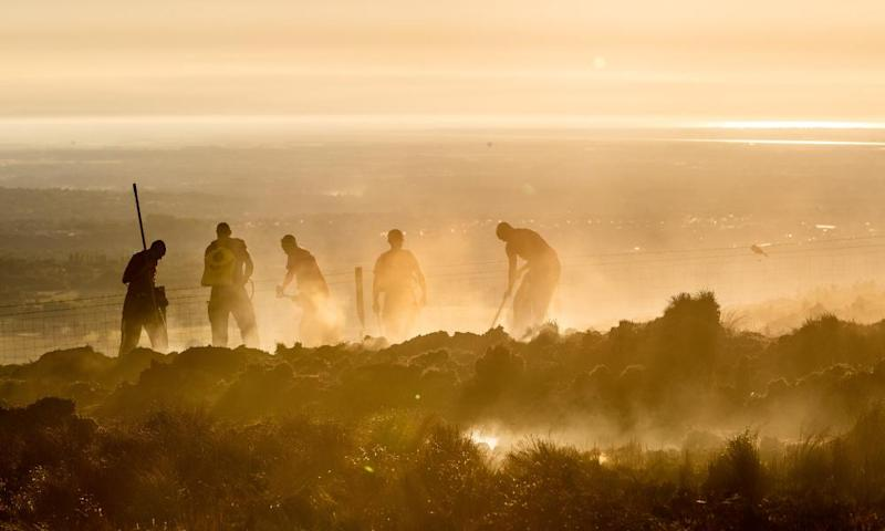 Winter Hill wildfire, near Bolton in Lancashire. 'Anyone who read the news' could see mounting evidence of the effects of climate change, Lord Deben said.