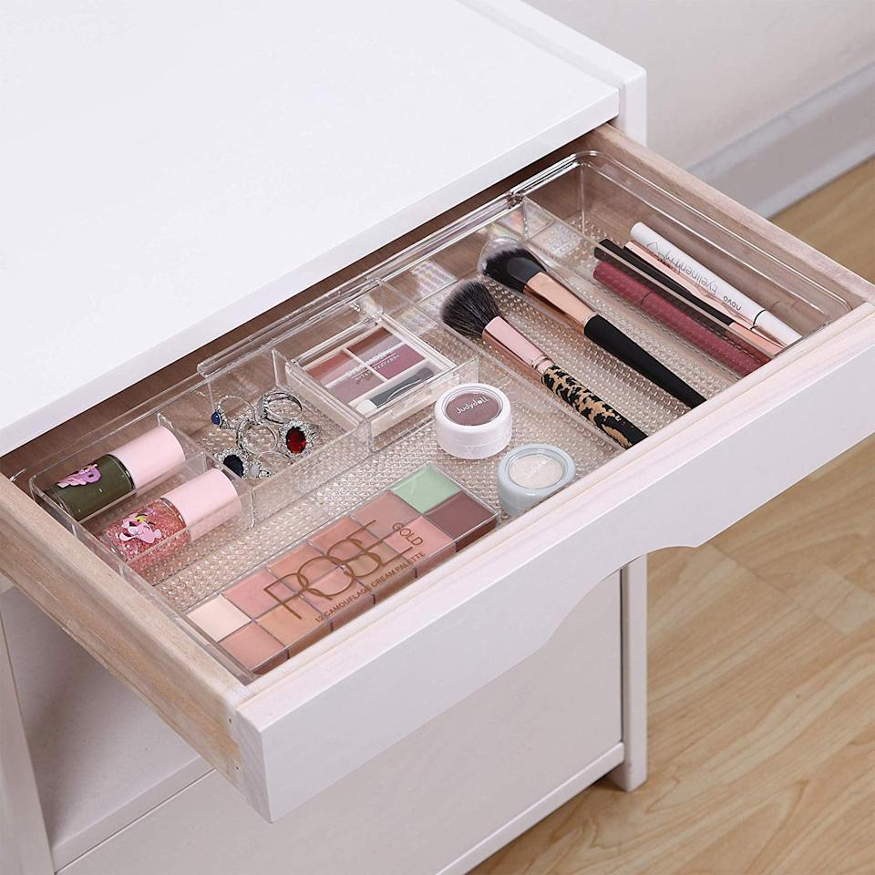 """<p>Keep your brushes and makeup palettes in this <a href=""""https://www.popsugar.com/buy/MoMA-Expandable-Makeup-Organizer-482968?p_name=MoMA%20Expandable%20Makeup%20Organizer&retailer=amazon.com&pid=482968&price=26&evar1=casa%3Aus&evar9=46525865&evar98=https%3A%2F%2Fwww.popsugar.com%2Fhome%2Fphoto-gallery%2F46525865%2Fimage%2F46526238%2FMoMA-Expandable-Makeup-Organizer&list1=shopping%2Corganizing%2Corganization%2Chome%20organization%2Chome%20shopping&prop13=mobile&pdata=1"""" rel=""""nofollow"""" data-shoppable-link=""""1"""" target=""""_blank"""" class=""""ga-track"""" data-ga-category=""""Related"""" data-ga-label=""""https://www.amazon.com/MoMA-Expandable-Makeup-Organizer-Countertops/dp/B07JPH1PNC/ref=sr_1_23?keywords=drawer+organizer&amp;qid=1566414014&amp;s=home-garden&amp;sr=1-23"""" data-ga-action=""""In-Line Links"""">MoMA Expandable Makeup Organizer</a> ($26).</p>"""
