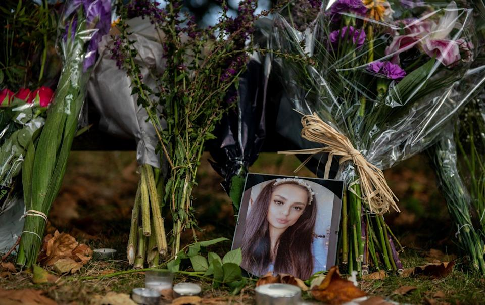 A photo of Sabina Nessa is seen amongst floral tributes and messages at Cator Park - Chris J Ratcliffe/Getty Images