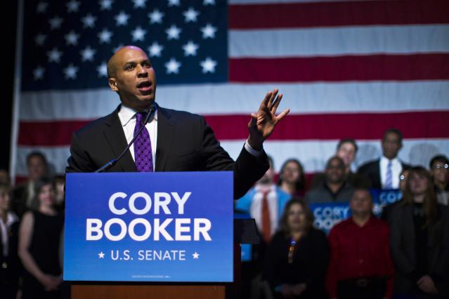 U.S. Senate candidate Cory Booker speaks during his campaign's election night event in Newark, New Jersey, October 16, 2013. Voters headed to the polls on Wednesday in New Jersey, where Booker, the charismatic Democratic mayor of Newark, was heavily favored to beat conservative Republican Steve Lonegan in a special election to fill the state's vacant U.S. Senate seat. REUTERS/Eduardo Munoz (UNITED STATES - Tags: POLITICS ELECTIONS)