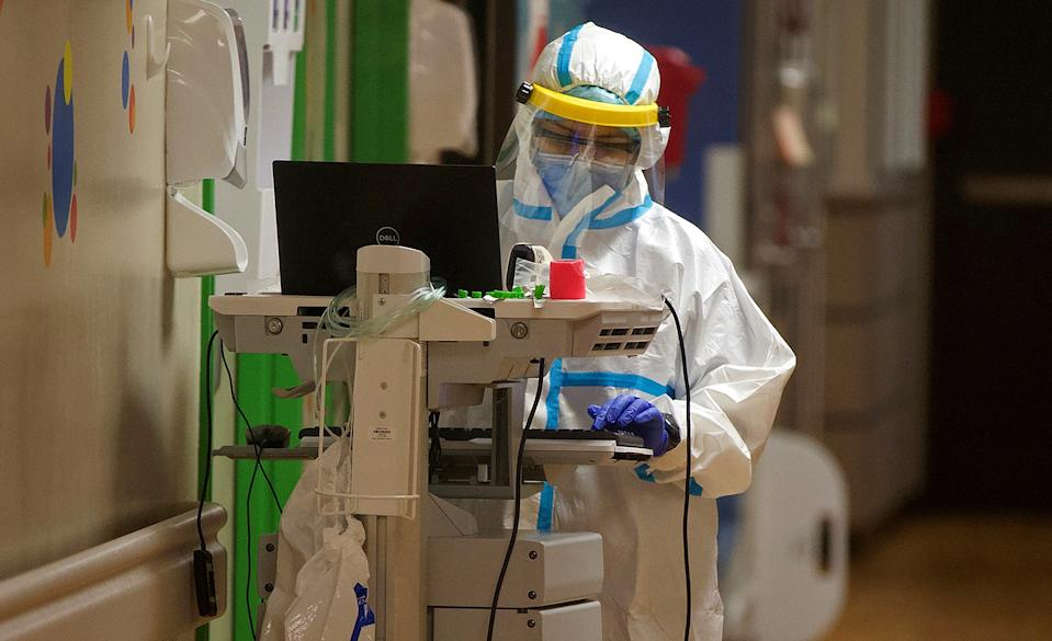 A medical staff member at Val Verde Regional Medical Center works on a COVID-19 isolation unit Thursday, July 23, 2020 in a hospital that has been described as a 'war zone' in the fight against the virus.