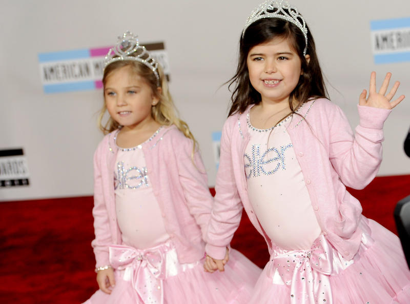 "FILE - In this Sunday, Nov. 20, 2011 file photo, Sophia Grace Brownlee, right, and her cousin Rosie Grace McClelland arrive at the 39th Annual American Music Awards in Los Angeles. The parents of Sophia Grace made a video of her rapping and singing Nicki Minaj's song ""Super Bass."" Deemed ""cute"" and ""adorable"" by the video's many viewers on YouTube, she later performed the song on Ellen DeGeneres' talk show. Minaj herself urged the girl to sing a tamer part of the song when she appeared on the show with Sophia Grace. (AP Photo/Chris Pizzello)"